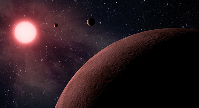 Artist's concept depicts an itsy bitsy planetary system