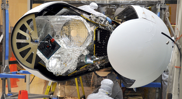 An Orbital Sciences technician completes final checks of NASA's Nuclear Spectroscopic Telescope Array