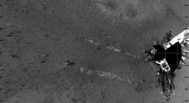 This overhead view shows evidence of a successful first test drive for NASA's Curiosity rover