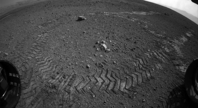 This image shows the tracks left by NASA's Curiosity rover on Aug. 22, 2012, as it completed its first test drive on Mars