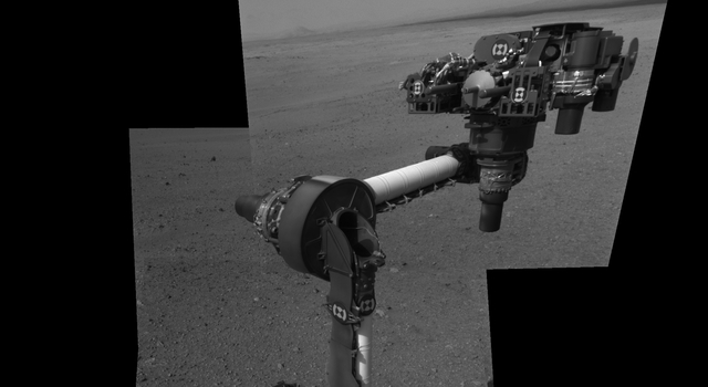 The extended robotic arm of NASA's Mars rover Curiosity can be seen in this mosaic of full-resolution images from Curiosity's Navigation camera (Navcam)