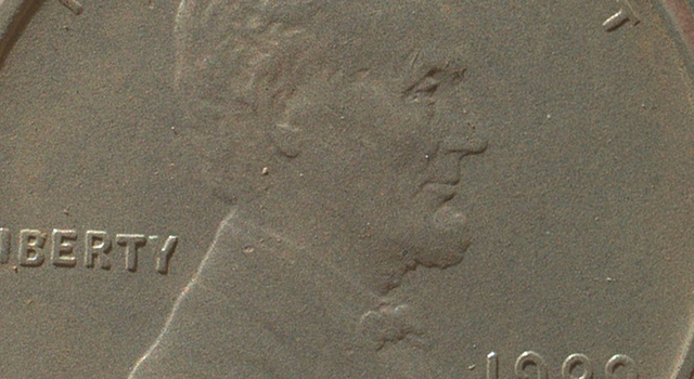 Martian Sand Grains on Penny