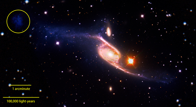 This composite of the giant barred spiral galaxy NGC 6872 combines visible light