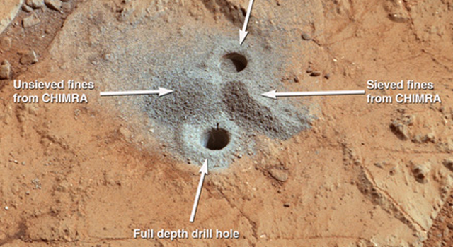 This image shows the first holes into rock drilled by NASA's Mars rover Curiosity