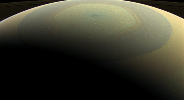 The globe of Saturn, seen here in natural color, is reminiscent of a holiday ornament in this wide-angle view from NASA's Cassini spacecraft
