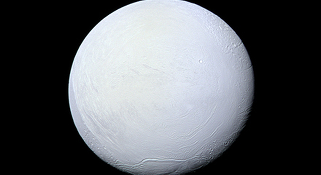 Saturn's moon Enceladus, covered in snow and ice, resembles a perfectly packed snowball in this image from NASA's Cassini mission