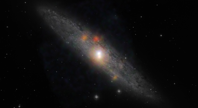 The Sculptor galaxy is seen in a new light, in this composite image from NASA's Nuclear Spectroscopic Telescope Array (NuSTAR) and the European Southern Observatory in Chile