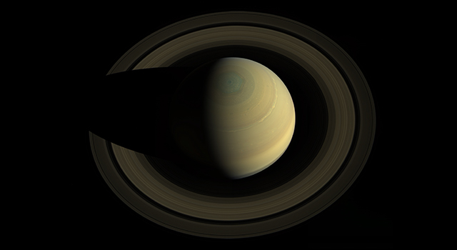 A swing high above Saturn by NASA's Cassini spacecraft revealed this stately view of the golden-hued planet and its main rings