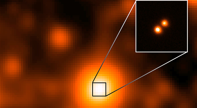 The third closest star system to the sun, called WISE J104915.57-531906, is at the center of the larger image, which was taken by NASA's Wide-field Infrared Survey Explorer