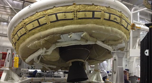 A saucer-shaped test vehicle holding equipment for landing large payloads on Mars