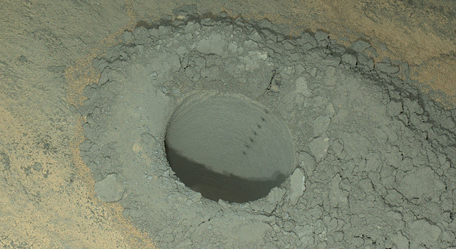 Hole produced by the rover's drill