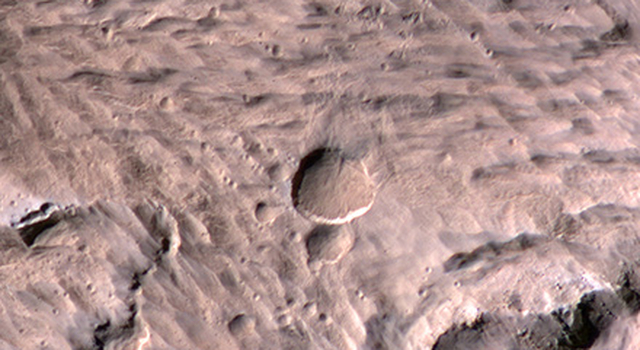 Large, Fresh Crater Surrounded by Smaller Craters