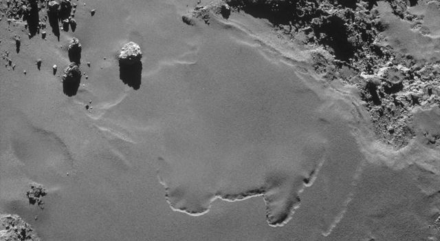 Smooth Ground on Rosetta's Destination Comet