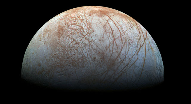 The puzzling, fascinating surface of Jupiter's icy moon Europa looms large in this reprocessed color view