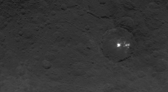 A cluster of mysterious bright spots on dwarf planet Ceres can be seen in this image