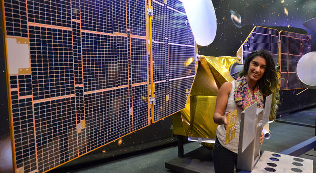 Full-scale mock-up of NASA's MarCO CubeSat held by Farah Alibay