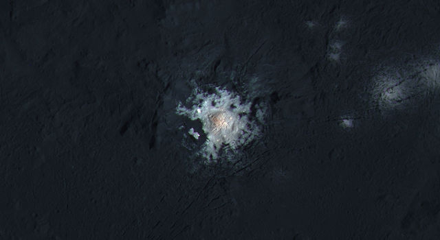 This image from NASA's Dawn spacecraft shows the bright spots of Occator Crater in enhanced color.