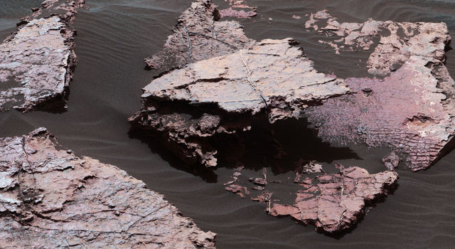 Possible Signs of Ancient Drying in Martian Rock
