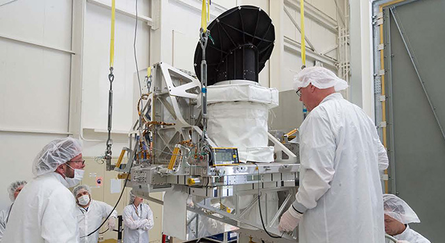 Technicians at NASA's Jet Propulsion Laboratory in Pasadena, California prepare NASA's International Space Station-RapidScat instrument
