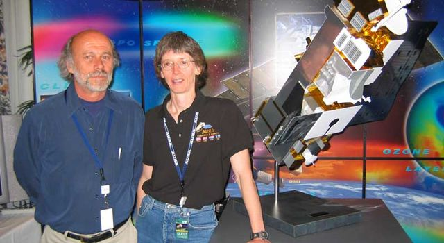 Santee and Dr. Joe Waters next to model of Aura spacecraft