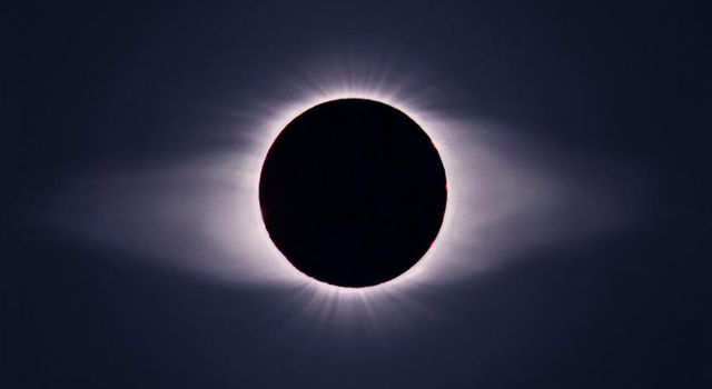 The solar corona, which produces solar wind, is evident in this eclipse.