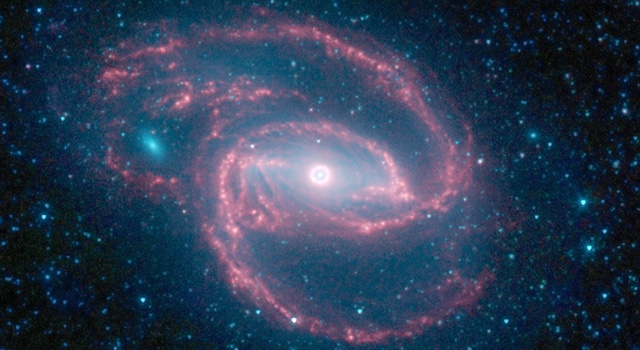 NASA's Spitzer Space Telescope has imaged a coiled galaxy with an eye-like object at its center.