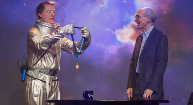 Galactic commander and talk show host Stephen 'Tiberius' Colbert presented Ed Stone