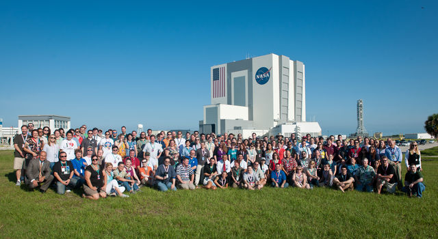 NASA and JPL personnel hold up wheels from Mars rovers through the years during the Mars Science Laboratory/Curiosity landing weekend NASA Social
