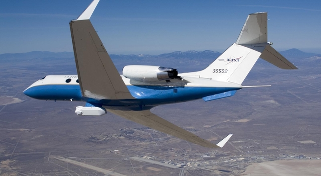 NASA's C-20A (G-III) banks over Edwards Air Force Base, Calif., carrying the UAVSAR underbelly pod