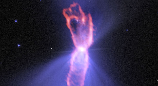 This composite image shows the Boomerang Nebula, a pre-planetary nebula produced by a dying star.
