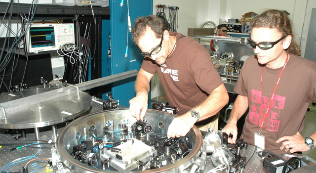 JPL researchers Glenn de Vine and Brent Ware with their LISA laser experiment.