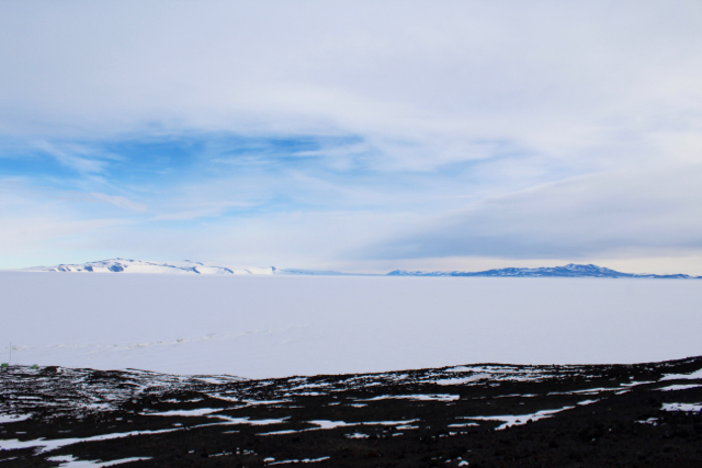 A view of White Island (left) and Black Island (right) on the drive between McMurdo Station and Scott Base en route to the Pressure Ridge Tour