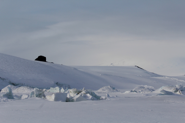 A view of Castle Rock taken from the pressure ridges between the Ross Sea Ice and the Ross Permanent Ice Shelf