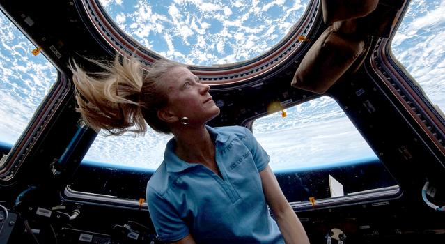 Astronaut Karen Nyberg looks at Earth from the International Space Station