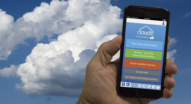 Person holding up a phone with the Globe Observer App Clouds tool on the screen