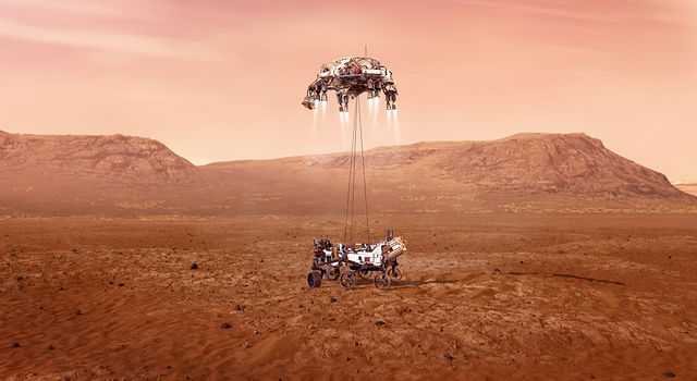 Artist's concept of the skycrane device lowering the Perseverance Mars rover onto the surface
