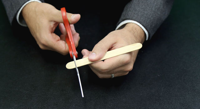 Cutting end of one popsicle stick