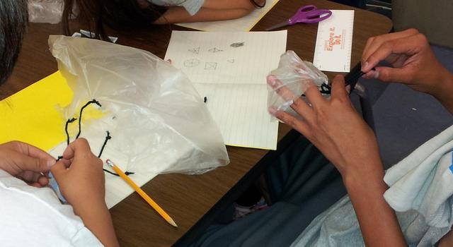 Students building parachutes