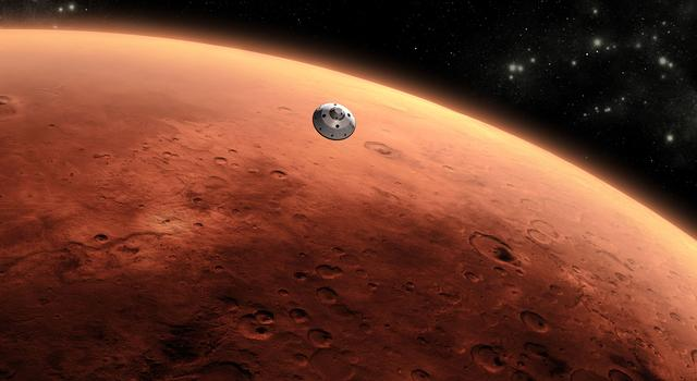 Mars appears bright orange as small silver capsule drops down into its atmosphere