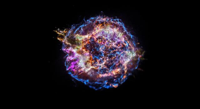 The supernova remnant of Cassiopeia A appears as an explosion of colors against the blackness of space.