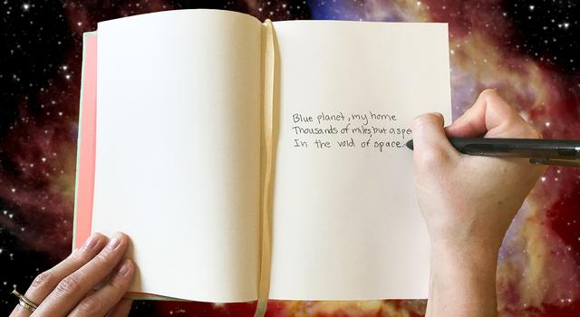 A person writes a poem about Earth in a journal.
