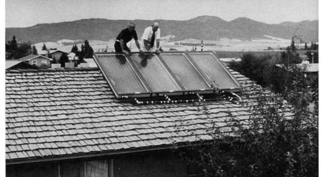 Solar water heater being installed on a home