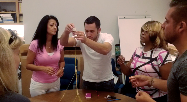 Teachers building a spaghetti tower