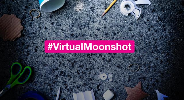Scissors, cups, a pencil and other materials scattered on the ground. A text overlay reads #VirtualMoonshot