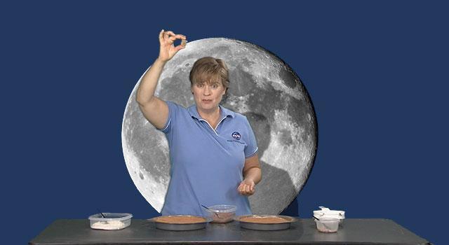 Ota Lutz preparing to drop a rock into her prepared lunar surface