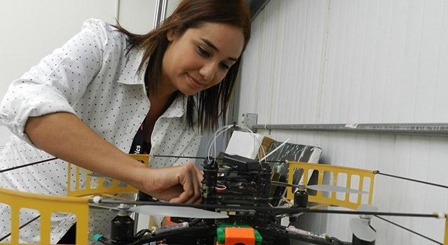 Lorenia Jimenez Miramontes works on a quadrotor at JPL