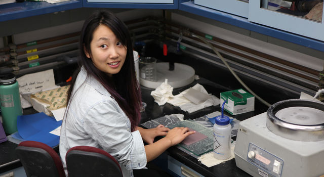 A JPL intern works in the lab