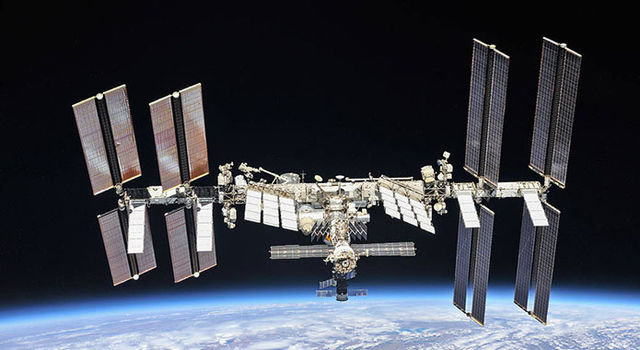 Image of the International Space Station flying above Earth