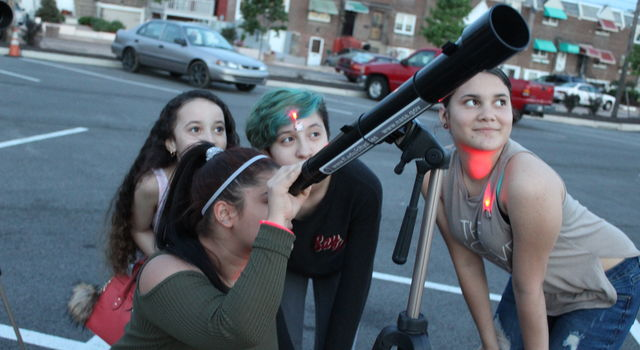 Girls at a NASA star party, astronomy event