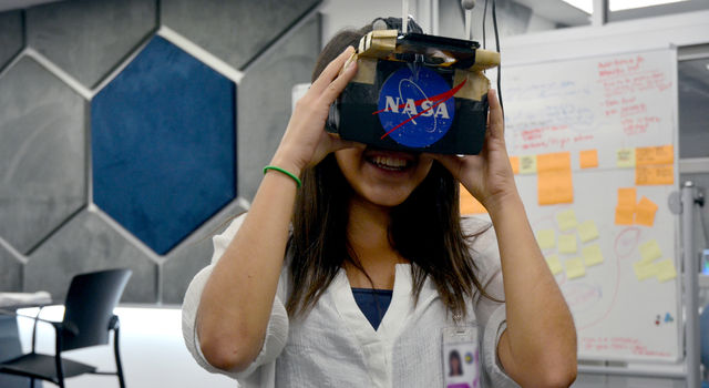 A student uses an AR device at JPL